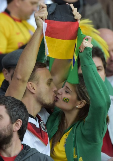 Fans kiss prior to the Round of 16 football match between Germany and Algeria at Beira-Rio Stadium in Porto Alegre during the 2014 FIFA World Cup on June 30, 2014. (Gabriel Bouys/Getty Images)