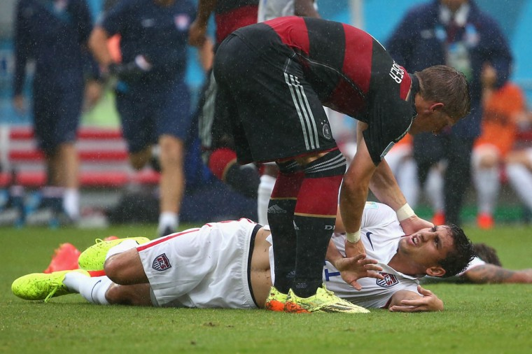 Bastian Schweinsteiger of Germany stands over Alejandro Bedoya of the United States during the 2014 FIFA World Cup Brazil group G match between the United States and Germany at Arena Pernambuco on June 26, 2014 in Recife, Brazil. (Robert Cianflone/Getty Images)