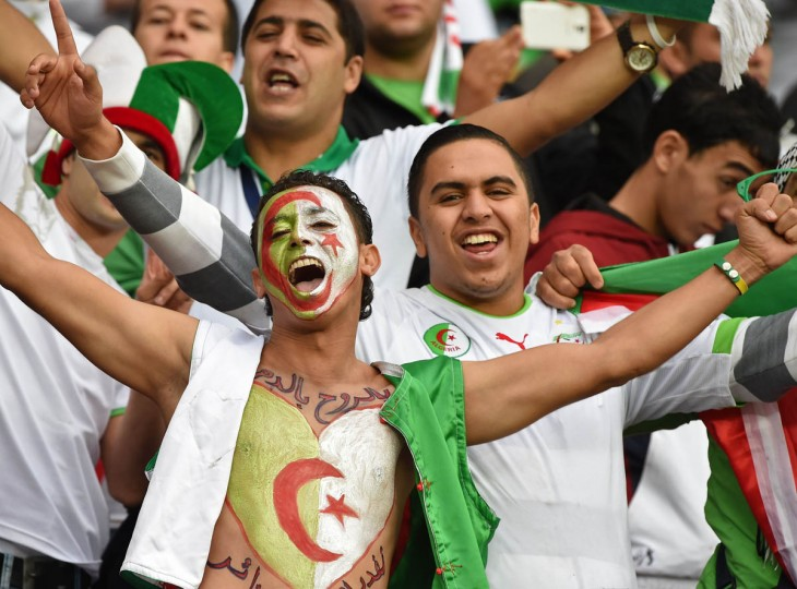 Algeria's fans cheer prior to the Round of 16 football match between Germany and Algeria at Beira-Rio Stadium in Porto Alegre during the 2014 FIFA World Cup on June 30, 2014. (Kirill Kudryavtsev/Getty Images)