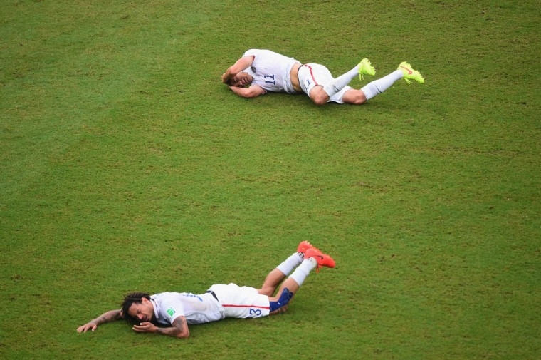 Jermaine Jones (front) of the United States and teammate Alejandro Bedoya lie on the field after colliding during the 2014 FIFA World Cup Brazil group G match between the United States and Germany at Arena Pernambuco on June 26, 2014 in Recife, Brazil. (Laurence Griffiths/Getty Images)
