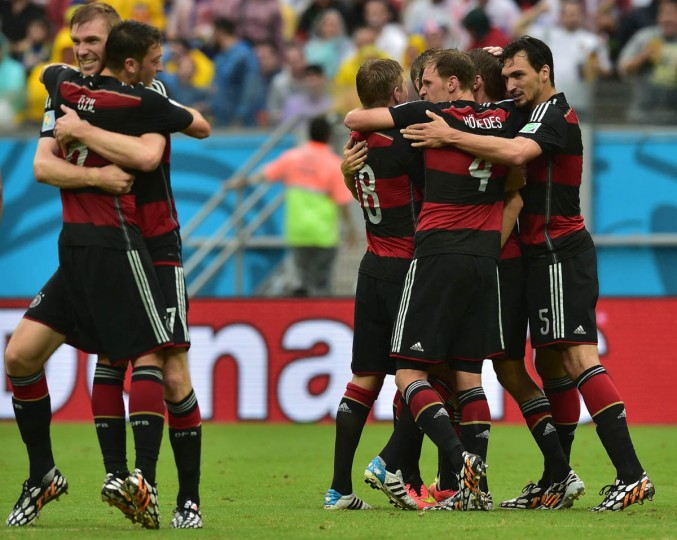 Germany's players celebrate after scoring their first goal during a Group G football match between US and Germany at the Pernambuco Arena in Recife during the 2014 FIFA World Cup on June 26, 2014. (Nelson Almeida/Getty Images)