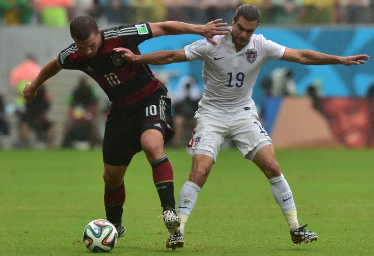 US midfielder Graham Zusi (Right) and Germany's forward Lukas Podolski vie for the ball during a Group G football match between US and Germany at the Pernambuco Arena in Recife during the 2014 FIFA World Cup on June 26, 2014. (Nelson Almeida/Getty Images)
