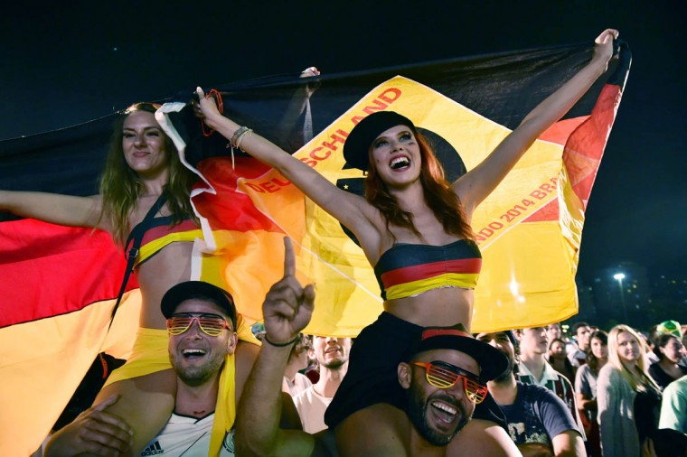 Germany's supporters react as they watch a Round of 16 football match between Germany and Algeria on a giant screen in Rio de Janeiro, during the 2014 FIFA World Cup on June 30, 2014. (Yasuyoshi Chiba/Getty Images)