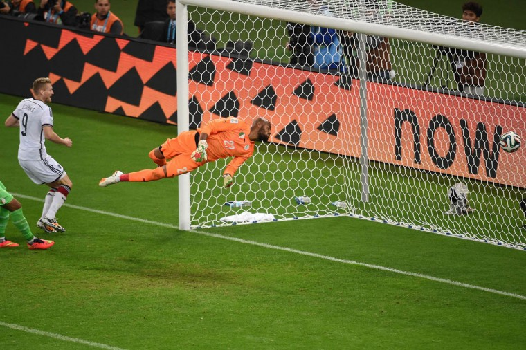 Germany's forward Andre Schuerrle (Left) scores past Algeria's goalkeeper Rais Mbohli during the Round of 16 football match between Germany and Algeria at Beira-Rio Stadium in Porto Alegre during the 2014 FIFA World Cup on June 30, 2014. (Christophe Simon/Getty Images)