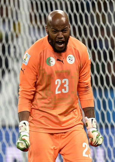 Algeria's goalkeeper Rais Mbohli reacts during a Round of 16 football match between Germany and Algeria at Beira-Rio Stadium in Porto Alegre during the 2014 FIFA World Cup on June 30, 2014. (Lucas Uebel/Getty Images)