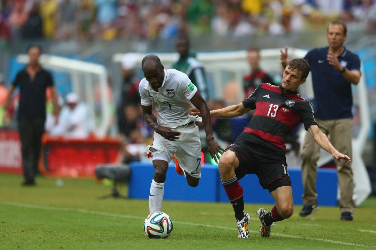 Thomas Mueller (Right) of Germany challenges DaMarcus Beasley of the United States during the 2014 FIFA World Cup Brazil Group G match between USA and Germany at Arena Pernambuco on June 26, 2014 in Recife, Brazil. (Michael Steele/Getty Images)