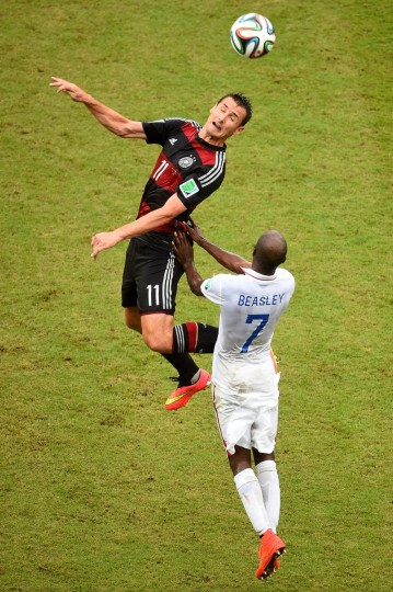 Miroslav Klose of Germany and DaMarcus Beasley of the United States go up for a header during the 2014 FIFA World Cup Brazil group G match between the United States and Germany at Arena Pernambuco on June 26, 2014 in Recife, Brazil. (Laurence Griffiths/Getty Images)
