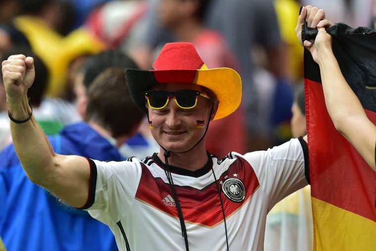 A German fan cheers during a Group G football match between US and Germany at the Pernambuco Arena in Recife during the 2014 FIFA World Cup on June 26, 2014. (Nelson Almeida/Getty Images)