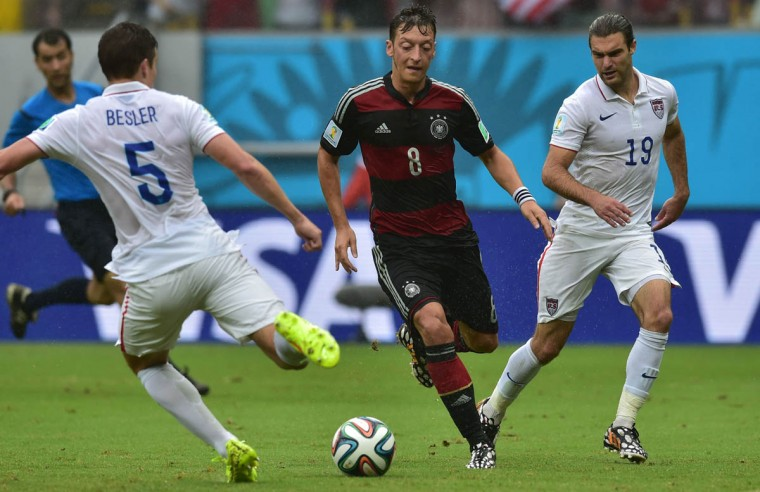 Germany's midfielder Mesut Ozil (Center), US defender Matt Besler (Left) and US midfielder Graham Zusi (Right) vie for the ball during a Group G football match between US and Germany at the Pernambuco Arena in Recife during the 2014 FIFA World Cup on June 26, 2014. (Nelson Almeida/Getty Images)