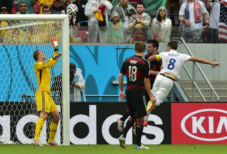 Germany's goalkeeper Manuel Neuer (Left) jumps for a ball shot by US forward Clint Dempsey (Right) who missed the goal during a Group G football match between US and Germany at the Pernambuco Arena in Recife during the 2014 FIFA World Cup on June 26, 2014. (Nelson Almeida/Getty Images)