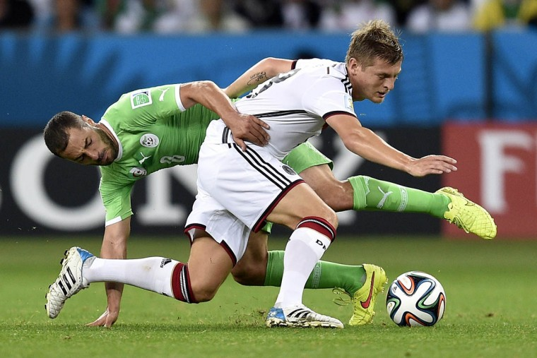Algeria's midfielder Medhi Lacen (Left) vies with Germany's midfielder Toni Kroos during a Round of 16 football match between Germany and Algeria at Beira-Rio Stadium in Porto Alegre during the 2014 FIFA World Cup on June 30, 2014. (Lucas Uebel/Getty Images)