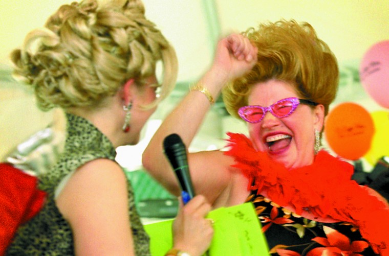"""Bawlmer's Best Hon Janet Trimble of Cub Hill celebrates the announcement of her new title by Cafe Hon owner Denise Whiting at """"Hon Fest"""" Saturday. Trimble grew up in Hampden. (Sun photo, 2001)"""