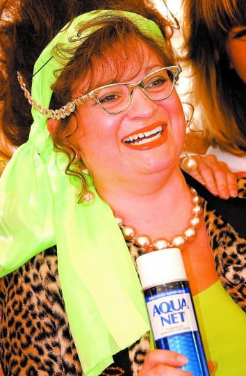 """Madge Poopa"", alias Jackie Garcia of Frederick, won the Miss Hon 2002 contest in Hampden Saturday, winning a dream day in Hampden worth about $900 and pair of plastic pink flamingos. She had it all, the black stretch pants, the lime-green high heels, blouse and scarf, the cat's-eye glasses, the leopard-print toreador jacket, the teased hair reaching to heaven. Her prize also includes riding in the Baltimore City Christmas parade this year. (Sun photo, 2002)"