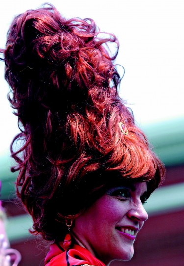 "Danielle Lynch of South Baltimore takes her hair to new heights for the ""Bawlmer's Best Hon"" contest on the Avenue in Hampden Saturday afternoon. Organized by Cafe Hon, the festival celebrated it's tenth year this past weekend. (Sun photo, 2003)"