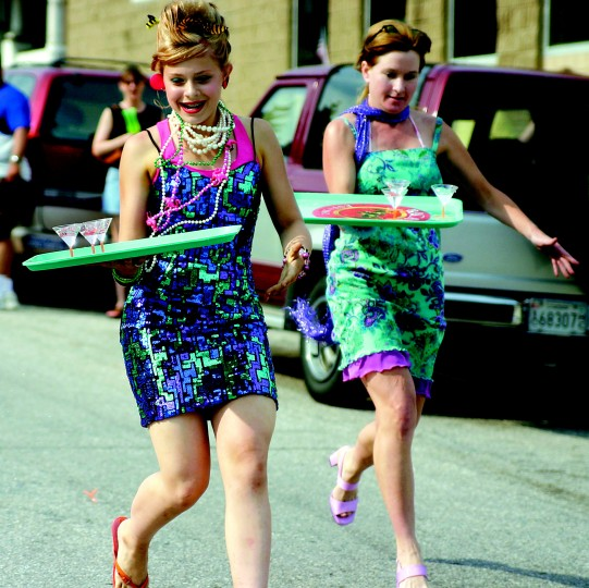 Gabrielle Willey (left), age 13 of Baltimore, and Laura Leary (right), of Parkton, compete in the final race of Hon Run. Willey wins first and Leary wins second, each receiving a Pony footwear prize pack. This is the first year there has been a Hon Run at HonFest. (Staff photo by Lisa Johnson)