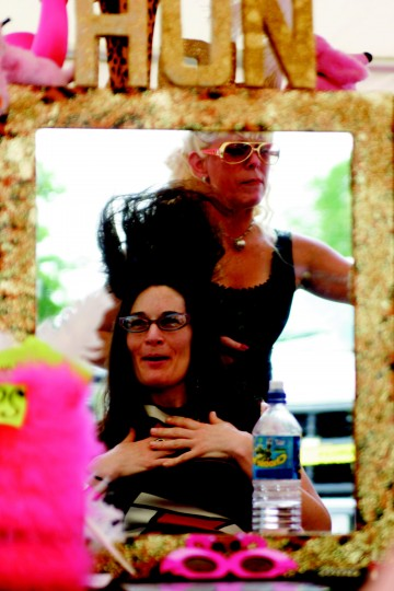 Sue Ebert (back), owner of Kumbyah, Inc., puts Sara Snyder's (front) hair in a beehive Saturday during HonFest in Hampden. Snyder, a College Park grad student originally from California, says she really enjoys the culture here. (Staff photo by Lisa Johnson)