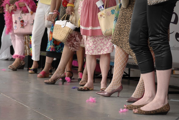 """The footwear of the fInalists for the title of """"Bawlmer's Best Hon,"""" shows their attention to detail as they waited on stage in the final stage of the competition. The 14th annual Honfest in Hampden was expanded this year to two days. (Sun photo, 2007)"""