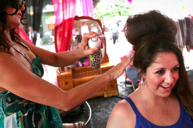 """Nasrene Mirjafary (right), of East Baltimore, gets her """"hair did"""" by Cynthia Imperatore (left), of Kumbyah, Inc. Hair Salon at HonFest 2010 on Sunday, June 13."""