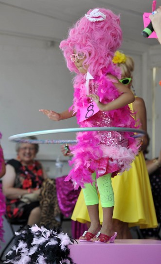 Baltimore, MD--6/9/12--Eva Dorsey, 6, Reisterstown, shows her hooping skills in the Little Miss Hon contests at HonFest in Hampden. (Kim Hairston/Baltimore Sun Staff)