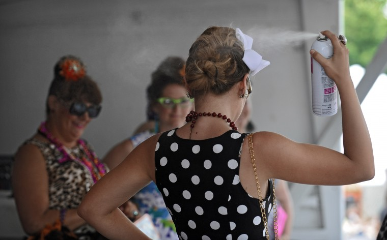 """Baltimore, Md.--6/8/13-- Miss Best Hon contestant JennaMarie Hill, of Columbia, put on more hairspray to hold her """"Do"""" as she competes during the 20th annual Honfest in Hampden. (Photo by: Kenneth K. Lam/Baltimore Sun )"""