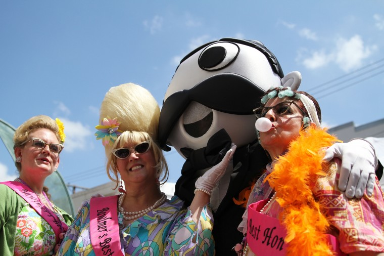 Hampden,MD - 6/9/13 - Miss Hon 2004 Heidi Trasatti (far left), Miss Hon 2009 Charlene Osborne and Miss Hon 2003 Rita Moore (right) pose with Mr. Natty Boh at the 2013 Honfest in Hampden. (Erin Kirkland/Baltimore Sun)