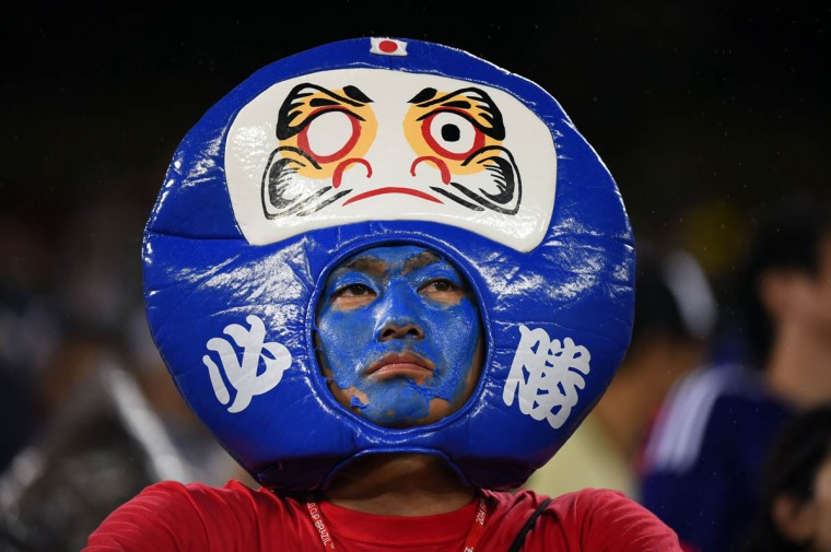 A Japanese fan reacts after a Group C football match between Japan and Greece at the Dunas Arena in Natal during the 2014 FIFA World Cup on June 19, 2014. (Fabrice Coffrini/Getty Images)