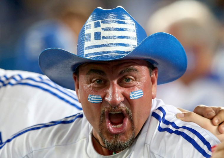 A Greece fan cheers during the 2014 FIFA World Cup Brazil Group C match between Japan and Greece at Estadio das Dunas on June 19, 2014 in Natal, Brazil. (Mark Kolbe/Getty Images)