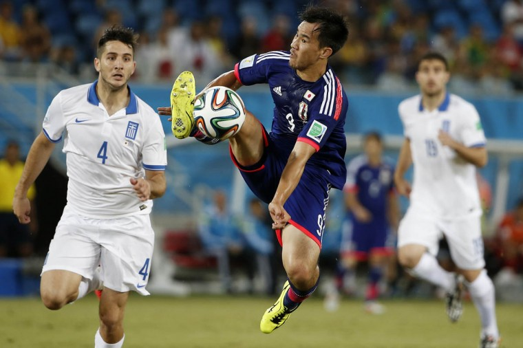 Japan defender Gotoku Sakai (3) tries to gather in a ball behind Greece defender Kostas Manolas (4) during the first half of their 2014 World Cup game at Estadio das Dunas. (Winslow Townson/USA TODAY Sports)
