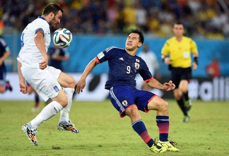 Greece's defender Vasilis Torosidis (Left) vies with Japan's forward Shinji Okazaki (Right) during a Group C football match between Japan and Greece at the Dunas Arena in Natal during the 2014 FIFA World Cup on June 19, 2014. (Tishifumi Kitamura/Getty Images)