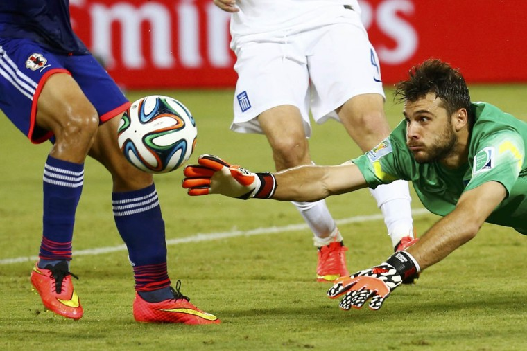 Greece's Orestis Karnezis dives forward to intercept the ball during their 2014 World Cup Group C soccer match against Japan at the Dunas arena in Natal June 19, 2014. (Kai Pfaffenbach/Reuters photo)