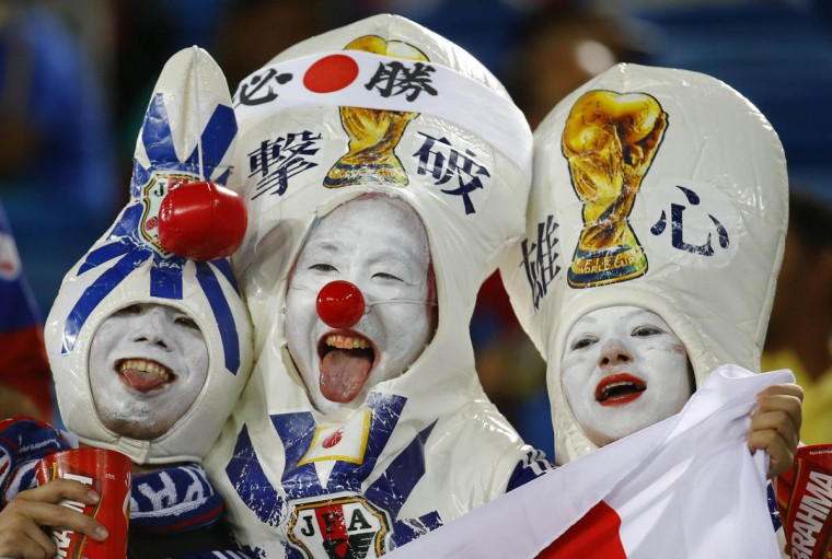 Fans of Japan pose before the start of the 2014 World Cup Group C soccer match at the Dunas arena in Natal June 19, 2014. (Kai Pfaffenbach/Reuters photo)