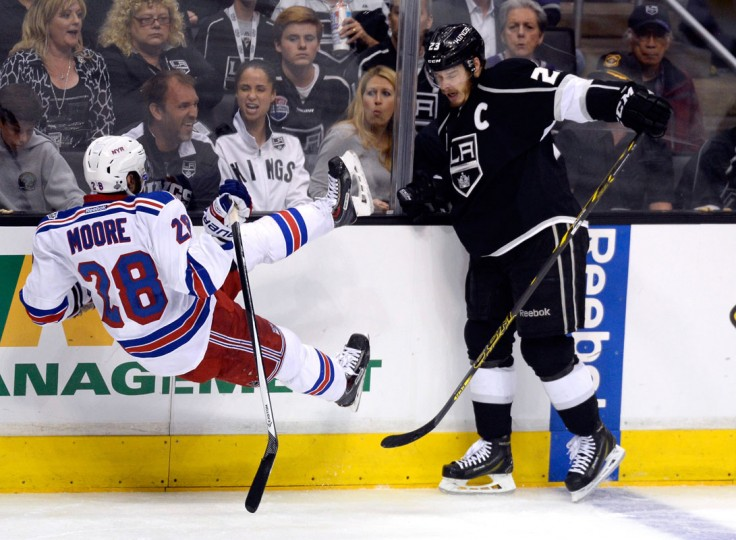 Dustin Brown #23 of the Los Angeles Kings checks Dominic Moore #28 of the New York Rangers in the second period during Game Five of the 2014 Stanley Cup Final at Staples Center on June 13, 2014 in Los Angeles, California. (Kevork Djansezian/Getty Images)