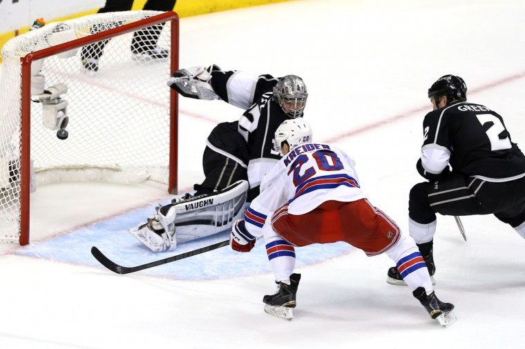 Chris Kreider #20 of the New York Rangers scores a second period goal past goaltender Jonathan Quick #32 of the Los Angeles Kings during Game Five of the 2014 Stanley Cup Final at Staples Center on June 13, 2014 in Los Angeles, California. (Christian Petersen/Getty Images)