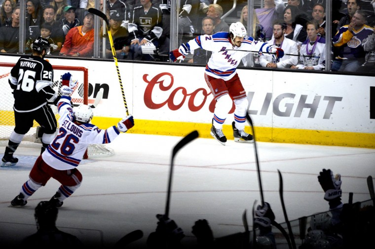 Brian Boyle #22 of the New York Rangers celebrates with teammate Martin St. Louis #26 after Boyle scores a second period goal past goaltender Jonathan Quick #32 of the Los Angeles Kings during Game Five of the 2014 Stanley Cup Final at Staples Center on June 13, 2014 in Los Angeles, California. (Kevork Djansezian/Getty Images)