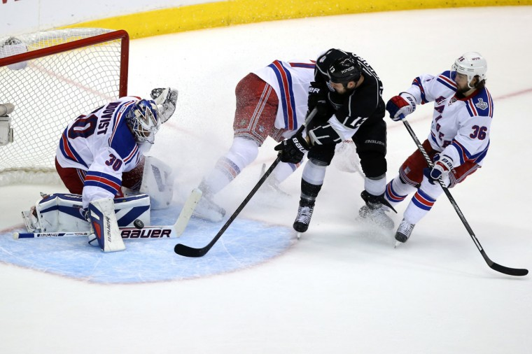 Kyle Clifford #13 of the Los Angeles Kings takes a shot against goaltender Henrik Lundqvist #30 of the New York Rangers in the second period during Game Five of the 2014 Stanley Cup Final at Staples Center on June 13, 2014 in Los Angeles, California. (Bruce Bennett/Getty Images)