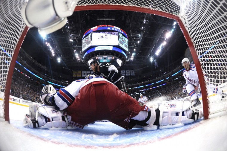 Jeff Carter #77 of the Los Angeles Kings looks to shoot against goaltender Henrik Lundqvist #30 of the New York Rangers in overtime during Game Five of the 2014 Stanley Cup Final at Staples Center on June 13, 2014 in Los Angeles, California. (Harry How/Getty Images)