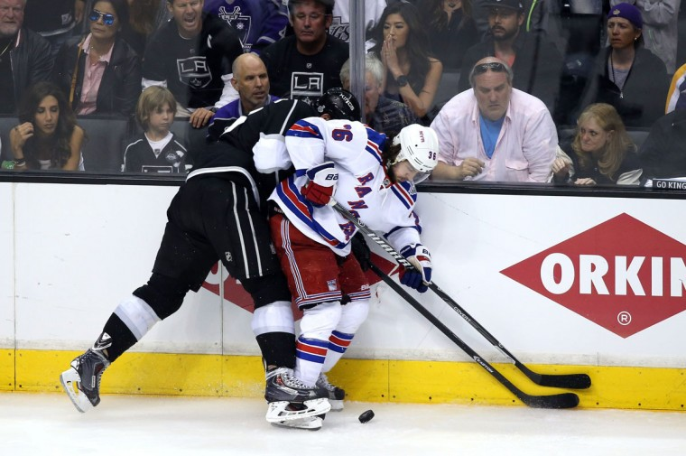 Jake Muzzin #6 of the Los Angeles Kings collides with Mats Zuccarello #36 of the New York Rangers during Game Five of the 2014 Stanley Cup Final at Staples Center on June 13, 2014 in Los Angeles, California. (Christian Petersen/Getty Images)
