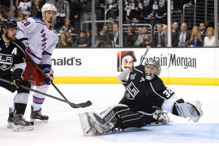 Goaltender Jonathan Quick #32 of the Los Angeles Kings attempts to make a save in double overtime against the New York Rangers during Game Five of the 2014 Stanley Cup Final at Staples Center on June 13, 2014 in Los Angeles, California. (Harry How/Getty Images)