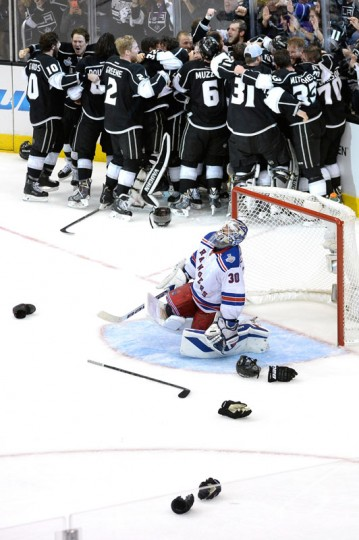 Alec Martinez #27 of the Los Angeles Kings and the Kings celebrate after scoring the game-winning goal in double overtime against the New York Rangers to win 3-2 in Game Five of the 2014 Stanley Cup Final at Staples Center on June 13, 2014 in Los Angeles, California. (Kevork Djansezian/Getty Images)