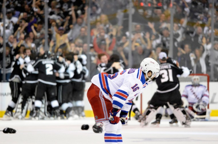 Derick Brassard #16 of the New York Rangers reacts after being defeated by the Los Angeles Kings 3-2 in double overtime of Game Five of the 2014 Stanley Cup Final at Staples Center on June 13, 2014 in Los Angeles, California. (Harry How/Getty Images)