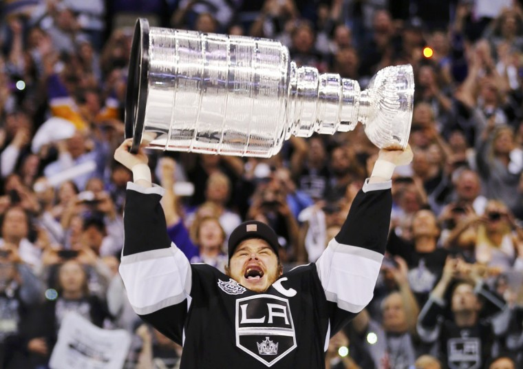 Los Angeles Kings captian Dustin Brown hoists the Stanley Cup after his team defeated the New Jersey Devils during Game 6 of the NHL Stanley Cup hockey final in Los Angeles, June 11, 2012. (Mike Blake/Reuters)