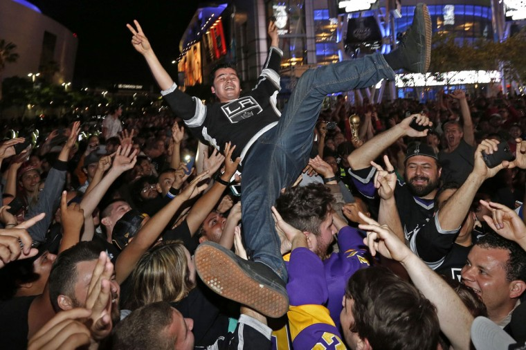 Los Angeles Kings hockey fans celebrate outside Staples Center after the Kings beat the New York Rangers 3-2 in the second overtime to win the Stanley Cup Finals in Los Angeles, California June 13, 2014. (Jonathan Alcorn/Reuters)