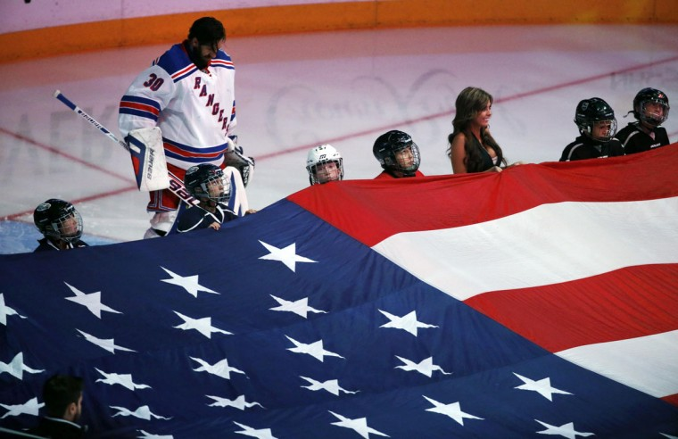 New York Rangers' goalie Henrik Lundqvist of Sweden listens to the American national anthem prior to the start of Game 5 of their NHL Stanley Cup Finals hockey series against the Los Angeles Kings in Los Angeles, California, June 13, 2014. (Lucy Nicholson /Reuters)