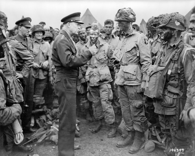 "General Dwight D. Eisenhower gives the order of the day on June 5, 1944, ""Full victory -- nothing else"" to paratroopers somewhere in England, just before they board their airplanes to participate in the first assault in the invasion of the continent of Europe. (Library of Congress)"