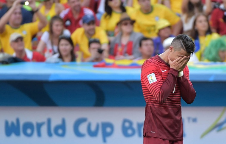 Portugal's forward and captain Cristiano Ronaldo reacts after the Group G football match between Portugal and Ghana at the Mane Garrincha National Stadium in Brasilia during the 2014 FIFA World Cup on June 26, 2014. (Gabriel Bouys/Getty Images)
