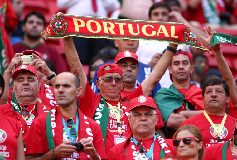 A Portugal fan holds a scarf during the 2014 FIFA World Cup Brazil Group G match between Portugal and Ghana at Estadio Nacional on June 26, 2014 in Brasilia, Brazil. (Photo by Adam Pretty/Getty Images)
