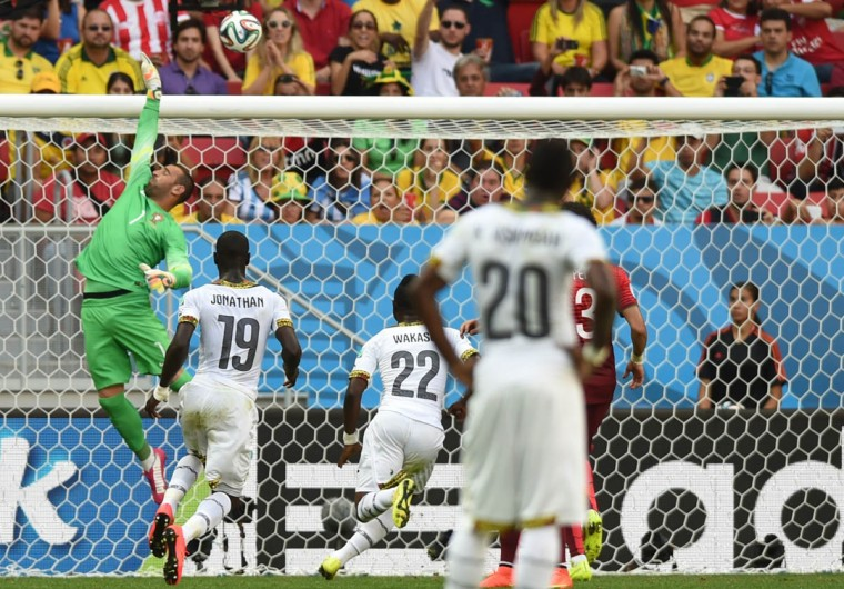 Portugal's goalkeeper Eduardo (Left) jumps for the ball during the Group G football match between Portugal and Ghana at the Mane Garrincha National Stadium in Brasilia during the 2014 FIFA World Cup on June 26, 2014. (Francisco Leong/Getty Images)