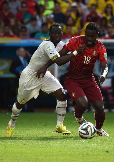 Ghana's midfielder Emmanuel Agyemang Badu (Left) and Portugal's forward Silvestre Varela vie for the ball during the Group G football match between Portugal and Ghana at the Mane Garrincha National Stadium in Brasilia during the 2014 FIFA World Cup on June 26, 2014. (Christophe Simon/Getty Images)