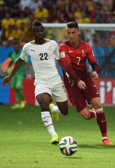 Ghana's midfielder Mubarak Wakaso (Left) and Portugal's forward and captain Cristiano Ronaldo vie for the ball during the Group G football match between Portugal and Ghana at the Mane Garrincha National Stadium in Brasilia during the 2014 FIFA World Cup on June 26, 2014. (Christophe Simon/Getty Images)