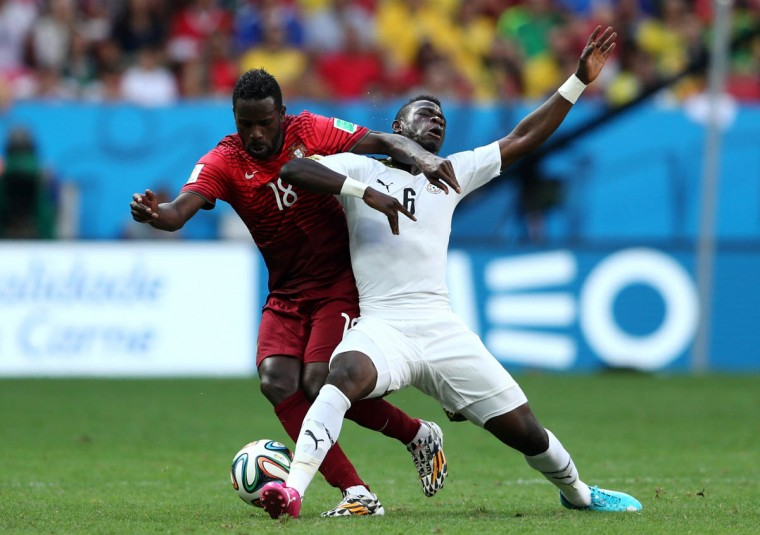 Silvestre Varela of Portugal and Acquah Afriyie of Ghana compete for the ball during the 2014 FIFA World Cup Brazil Group G match between Portugal and Ghana at Estadio Nacional on June 26, 2014 in Brasilia, Brazil. (Warren Little/Getty Images)